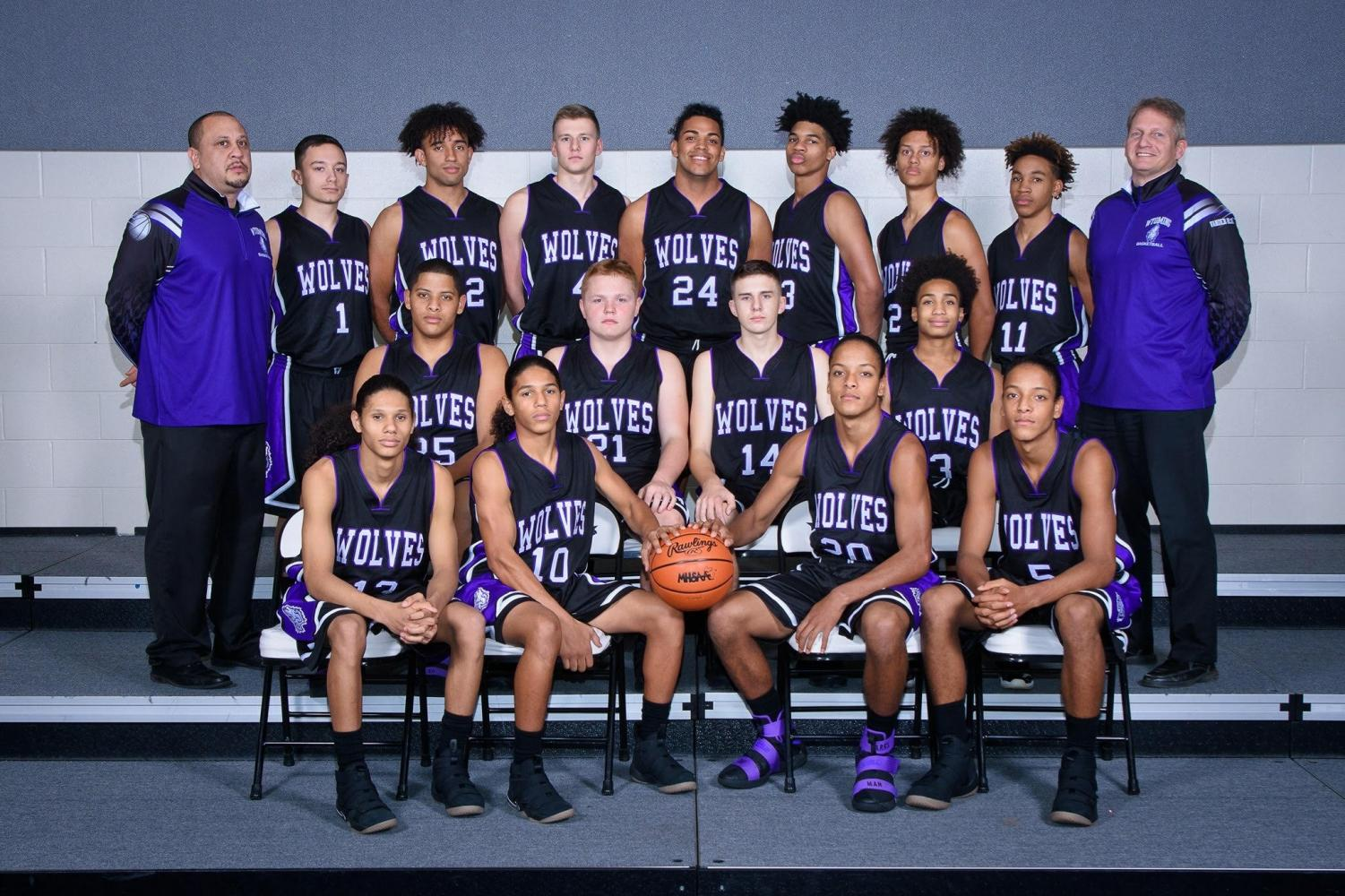 Coach Vander Klay with this year's Varsity Basketball Team.