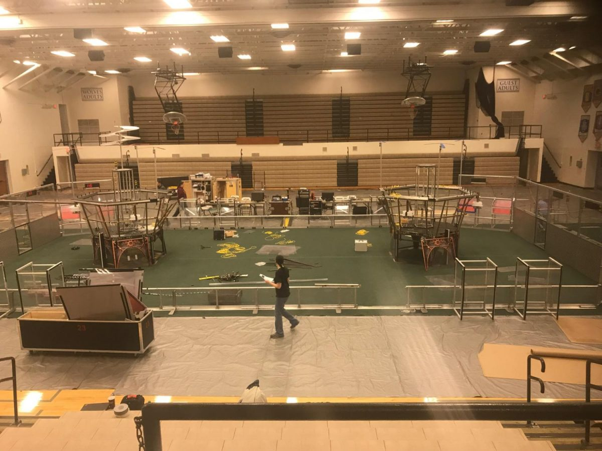Crews work to prepare the WHS gym for Saturday's event.