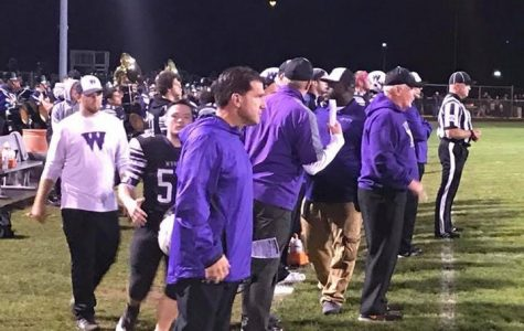 The Wolves coaches watch as the football team ends the season on a winning note.