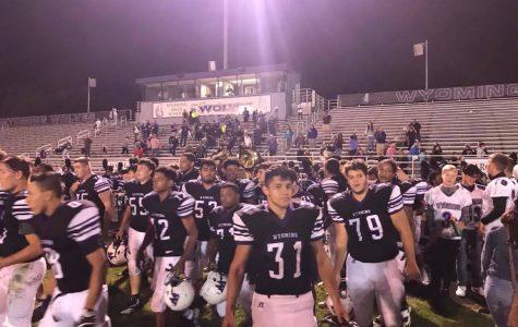 WHS Football Works Hard, Earns a Win