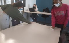 Students wiping down desks